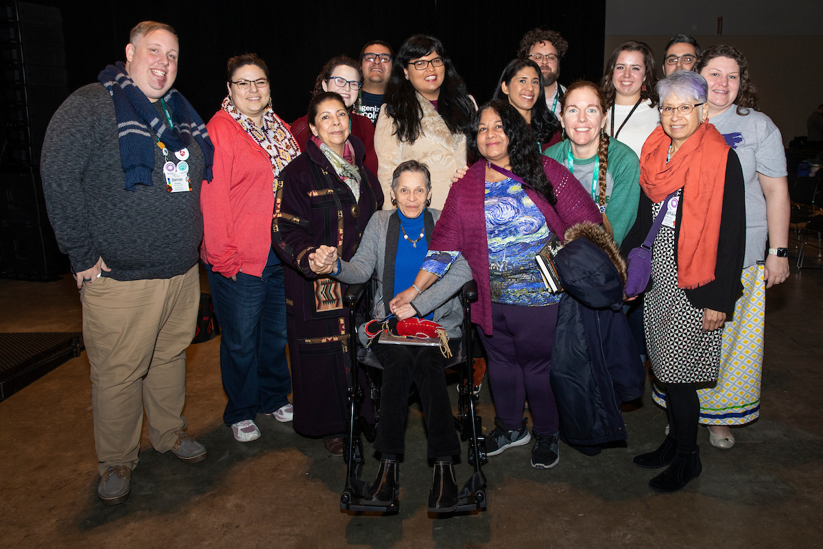 group of Indigenous members with the Elder at ACPA19
