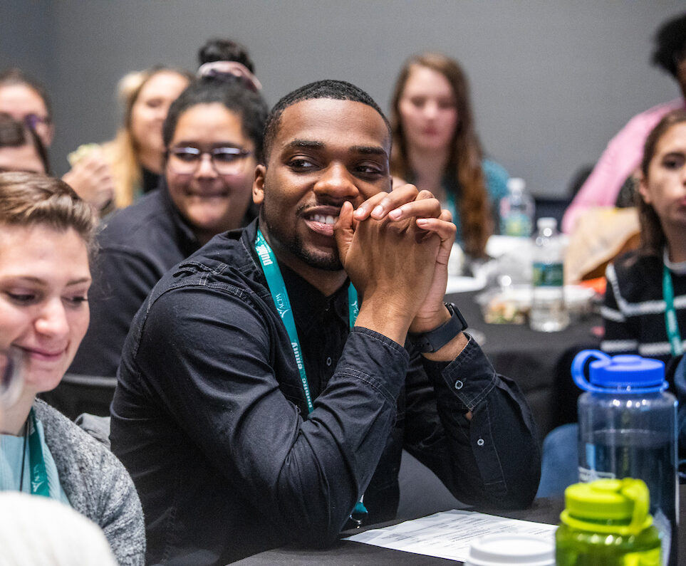 young student smiling during NextGen