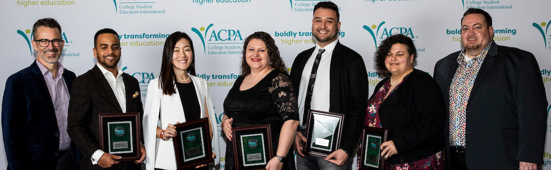 photo of all 2020 emerging scholars holding their awards at ACPA20