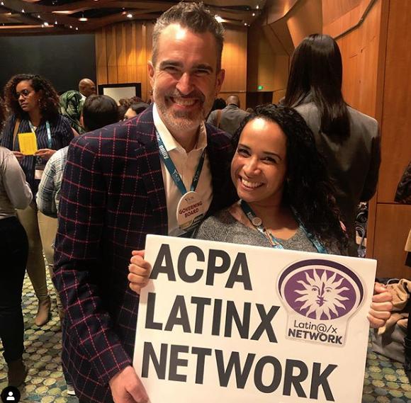 Craig Elliott and a member holding an ACPA Latinx network