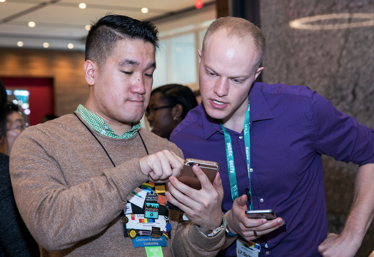 Two ACPA members looking at a phone