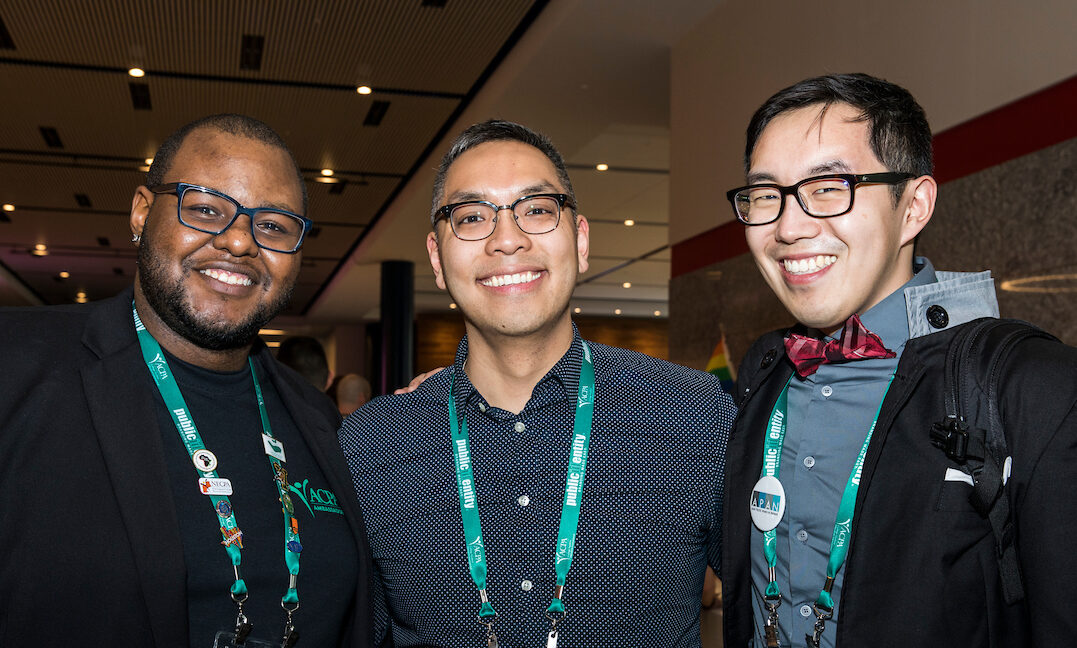 three ACPA members smiling and giving thumbs up