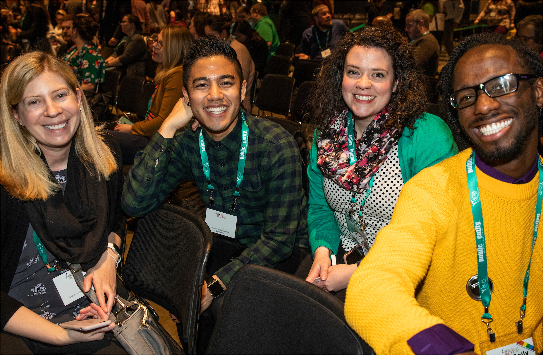 four ACPA members during Convention smiling at the camera